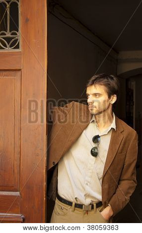 Hansome young man model with wooden door
