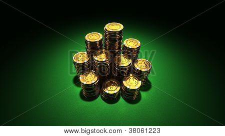 Large Group Of Gold Poker Chips On Green