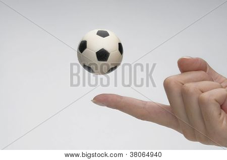 Soccer ball with female hand