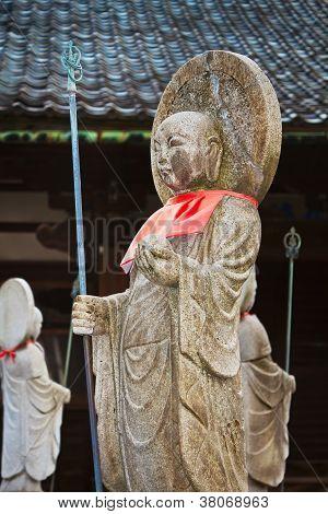 Japanese Buddha Statues (Jizo Bodhisattva) over a Graveyard
