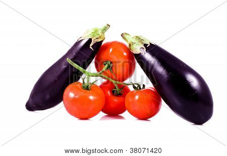 Fresh Red Tomatoes On Bunch And Eggplants