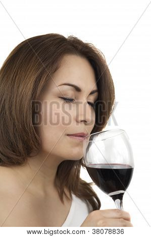 Woman tasting wine