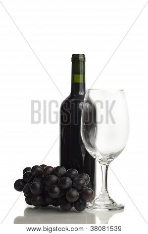 Wine bottle, glass and grape
