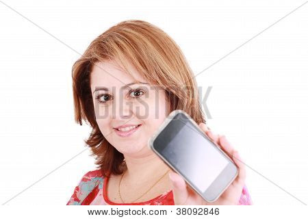 Portrait Of A Confident Young Woman Showing Mobile Phone Against White Background