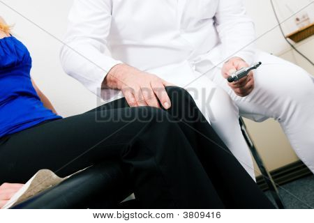 Doctor Testing Reflexes
