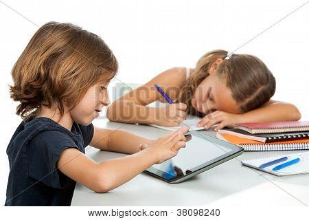 Small Boy Doing Homework On Tablet.