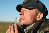 image of edelweiss  - Romantic man breathes scent of a flower edelweiss - JPG