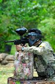 picture of gun shot wound  - Picture of man playing paintball in the jungle - JPG