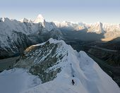 stock photo of sherpa  - two climbers about to summit island peak in nepal - JPG