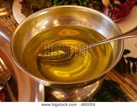 Oil In Silver Bowl