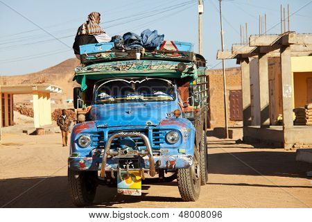 WADI HALFA, SUDAN - JANUARY 7: Sudanese peasant rides old truck on January 7, 2010 in border town of Wadi Halfa, Sudan. Sudan remains one of the least developed countries in the world.