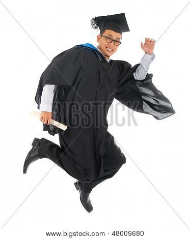 Full body excited Asian male university student in graduation gown jumping high or running isolated on white background