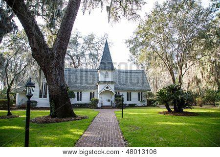 Small White Church Past Brick Walk And Gas Lamp
