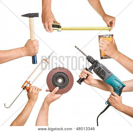 Various tools in a man's hand.