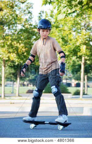 Teenage Boy Riding Skateboard
