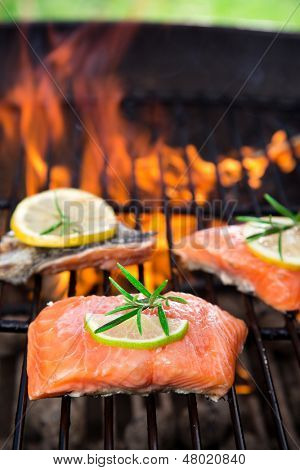 Salmon fillets on the grill with flames