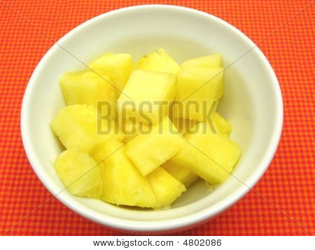 Pieces Of Pineapple In A White Bowl Of Chinaware