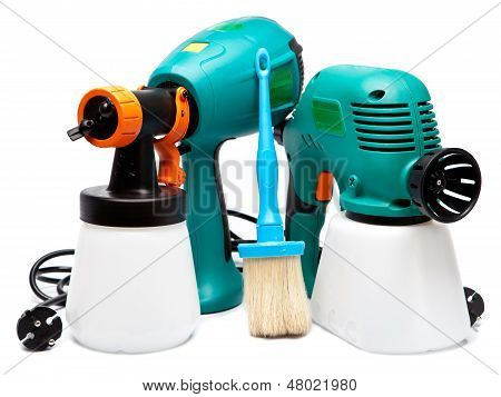 two different construction electrical spray gun for pulverization of color and a paintbrush