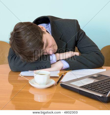 Businessman Has Fallen Asleep Sitting At Meeting