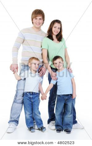 Full-length Portrait Of Young Happy Family