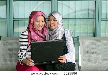 beautiful young muslim businesswoman sharing info