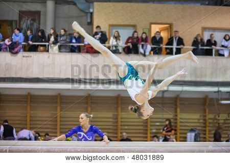 MOSCOW - DEC 15: The girl does the trick in Hall Dynamo Stadium at the XIX International Gymnastics Tournament for the Cup of Voronin on December 15, 2012 in Moscow, Russia.