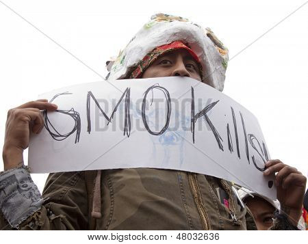 NEW YORK-MAY 25: A protestor holds a sign that says 'GMO Kills' at the March Against Monsanto rally in Union Square on May 25, 2013 in Manhattan. The rally was part of a global movement against GMO's.