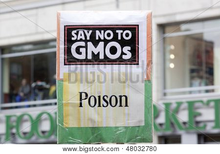 NEW YORK-MAY 25: A sign that says 'Say No To GMOs Poison' held by a protestor during the global March Against Monsanto as they pass in front of Whole Foods grocery store on May 25, 2013 in Manhattan.