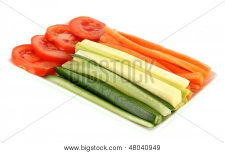 Assorted raw vegetables sticks in plate isolated on white