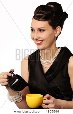 Smiling Stylish Lady In Classic Outfit Serving Coffee