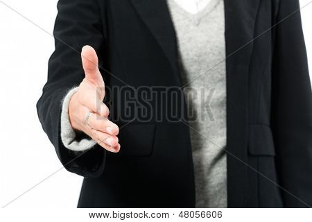 Young woman in front of white background, she introduces themselves and offers the hand, maybe she is a businesswoman or laywer