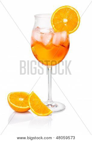 Aperol Spritz in a wine glass decorated with an orange slice