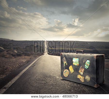 vintage suitcase on a deserted road