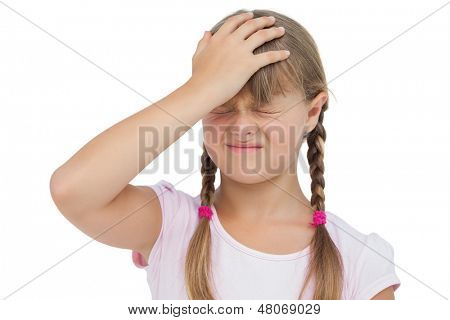 Little girl suffering from headache and touching her head on white background