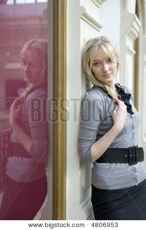 Young Attractive Blond Woman Standing At Wall In State Department Store. Moscow. Shopping