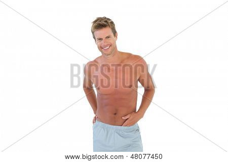 Shirtless attractive man gesturing on white background