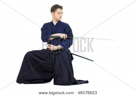 Handsome young man practicing kendo. Isolated over white.