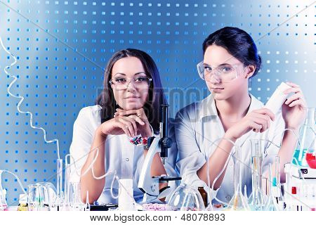 Laboratory staff in the working process. Laboratory equipment.
