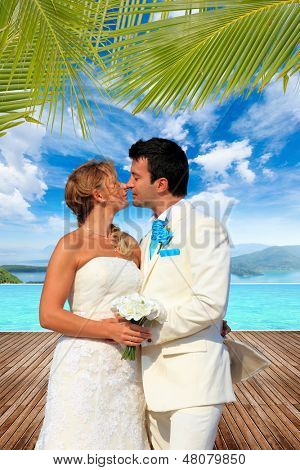 Couple on their wedding day  at summer resort