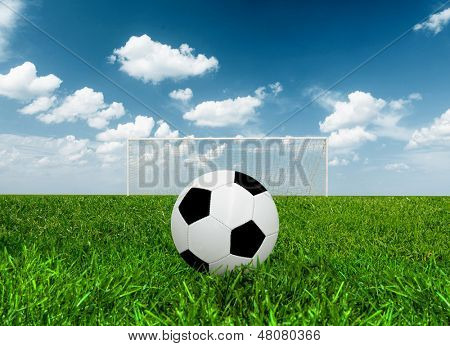 Football at penalty point in a field