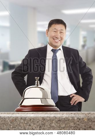 Asian hotel concierge.  Service bell at the hotel