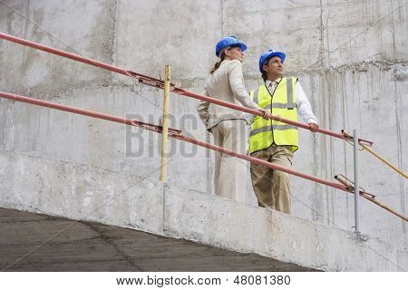 Low angle view of an architect and construction manager on site