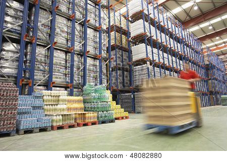 Blurred forklift driver warehouse