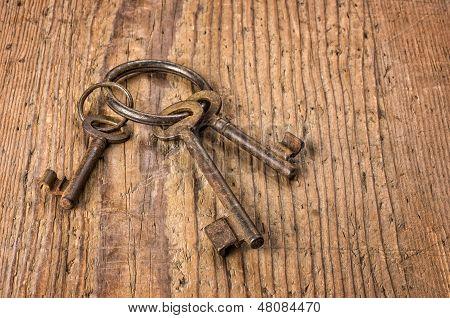 Three old keys on a key ring