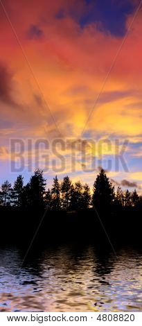 Red Clouds At Sunset Above Trees And Water On The Lake Tahoe California