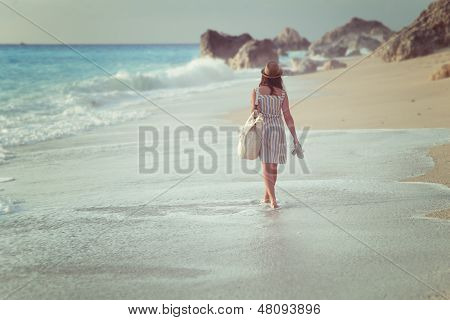 A girl walking on a beach