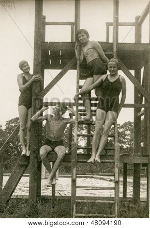 POLAND, CIRCA THIRTIES - vintage photo of four youngsters in swimming clothes, Poland, circa thirties