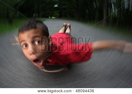 Boy lying on skateboard