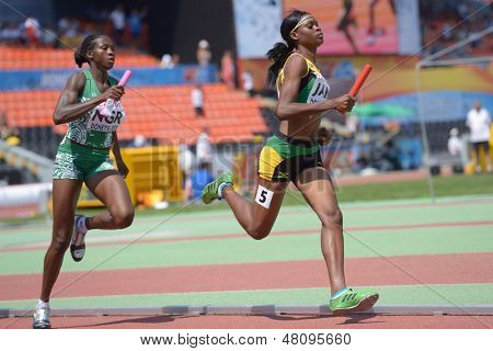 DONETSK, UKRAINE - JULY 13: Yanique McNeil, Jamaica (right) and Abimbola Junaid, Nigeria compete in the medley relay competitions during World Youth Championships in Donetsk, Ukraine on July 13, 2013