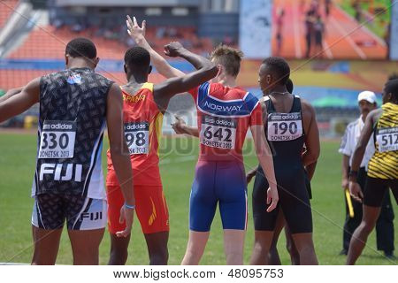 DONETSK, UKRAINE - JULY 13: Athletes wait for their turn in the boys medley relay during World Youth Championships in Donetsk, Ukraine on July 13, 2013